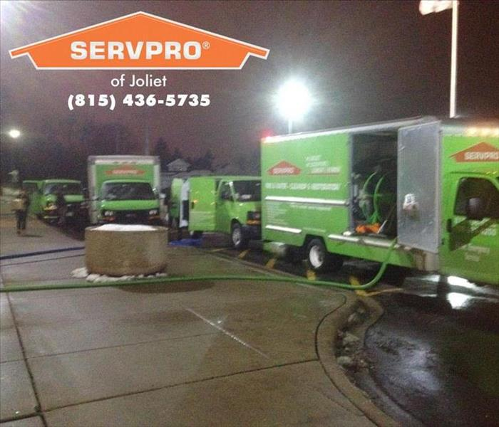 SERVPRO vehicles parked outside a business.